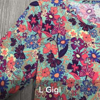 Gigi (L)